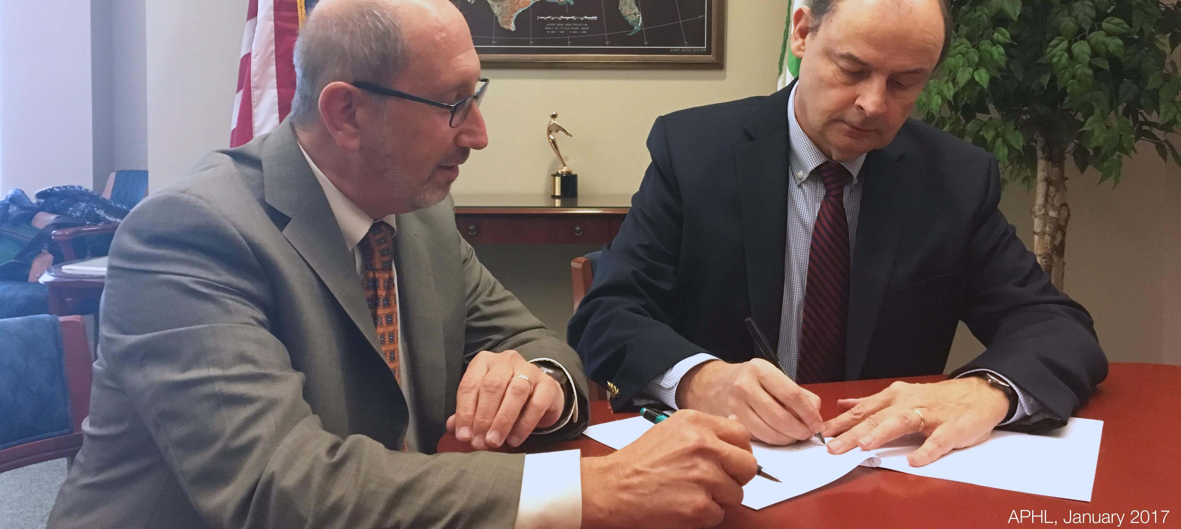 Scott Becker and Dr. Tom Burke sign APHL-EPA MOU