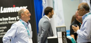 APHL exhibitor meets with attendee