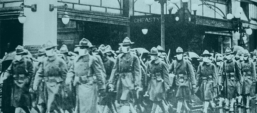 Protection against influenza, circa 1918. Soldiers wearing gazue masks walk down a street in Seattle, WA.