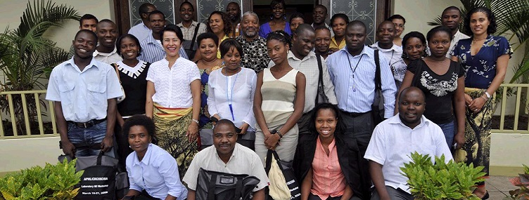 students and staff celebrate completion of lab training in Mozambique